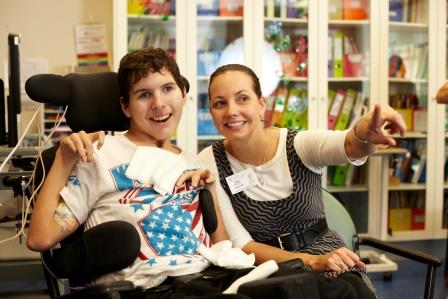 Young cerebral palsy boy with carer