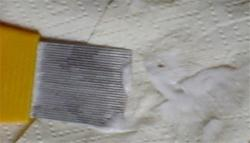 Nit comb wiped on paper towel